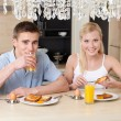 Couple has breakfast in the kitchen — Stock Photo