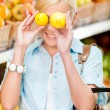 Girl at the shop choosing fruits — Stock Photo