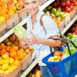 Girl at the shopping mall choosing vegetables — Stock Photo #36531877