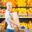Girl with cart hands paper bag — Stock Photo #36532243