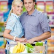 Stock Photo: Portrait of couple in the supermarket