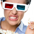 Headshot of the girl in 3D spectacles eating popcorn — Stock Photo #36533177