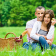 Couple has picnic in park — Stok fotoğraf