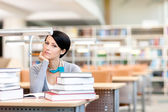 Pensive student studies at the reading hall — Stock Photo