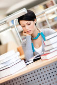 Woman studies at the library — Stock Photo