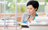 Woman studies at the reading hall — Stock Photo