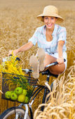 Girl rides bicycle — Stock Photo