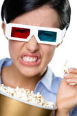 Headshot of the girl in 3D spectacles eating popcorn — Foto Stock
