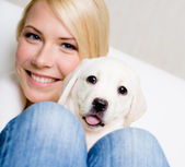 Woman with cute puppy on her knees — Stock Photo