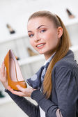 Woman keeping brown leather pump — Stock Photo