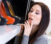 Close up of woman choosing a pair of shoes — Stock Photo