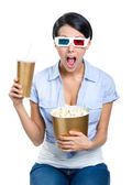 Girl in 3D glasses with drink and popcorn — Foto Stock