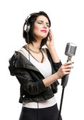Rock musician with microphone and earphones — Stock Photo