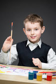 Boy painting something — Stockfoto
