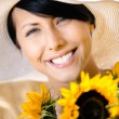 Woman with sunflowers in the field — Stock Photo