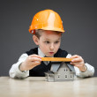 Little boy in headpiece with home model and ruler — Stock Photo #36983561