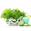 Close up view of green vegetables in white bowl and cocktail — Stock Photo #36983903