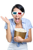 Viewer watching 3D film with popcorn — Stock Photo