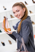 Woman keeping brown leather shoe — Stock Photo