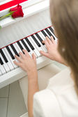 Close up of female hands playing piano — Stock Photo