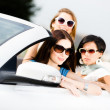 Group of pretty teenagers in the car — Stock Photo #39906919