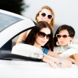 Group of pretty teenagers in the car — Stock Photo