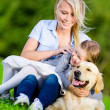 Mother and daughter with retriever are on the grass — Stock Photo