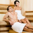 Half-naked man and young woman relaxing in sauna — Stock Photo #39907393