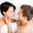 Close up of man stroking woman lying in bed — Stock Photo #39907581