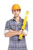 Foreman in range hard hat handing leveling instrument — Stock Photo