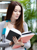 Female student reads books — Stock Photo