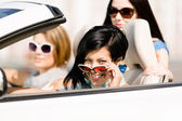 Group of girls in the convertible car — Stock Photo