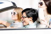 Group of girls in the car — Стоковое фото