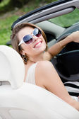 Portrait of pretty woman in the car — Stock Photo