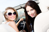 Two girls drive the car — Stock Photo
