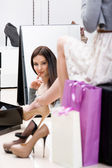Reflection of woman trying on footwear — Stock Photo