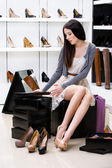 Woman trying on pumps in the shop — Stock Photo