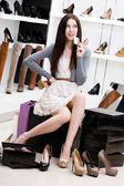 Woman keeps credit card in footwear shop — Stock Photo