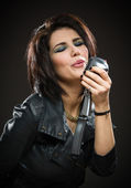 Female rock musician with mic — Stock Photo