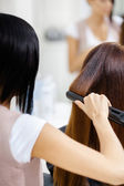 Hairdresser doing hair style for woman — Stock Photo