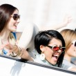Group of girls in the auto — Stock Photo #40400569