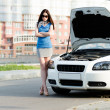 Woman near the broken car — Stock Photo #40400709
