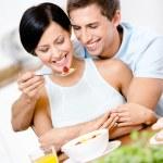 Man feeds and hugs his girlfriend — Stock Photo