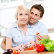 Young couple cooking salad together — Stock Photo