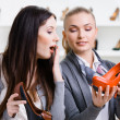 Stock Photo: Salesperson offers stylish pumps for customer