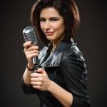 Female rock singer holding mike — Stock Photo #40405249