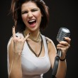 Rock singer with microphone — Stock Photo