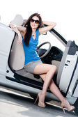 Pretty woman sits in the white car — Foto Stock