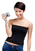 Creative girl holds amateur hand-held camera — Stock Photo