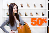 Portrait of girl in shop with 50 sale — Stock Photo
